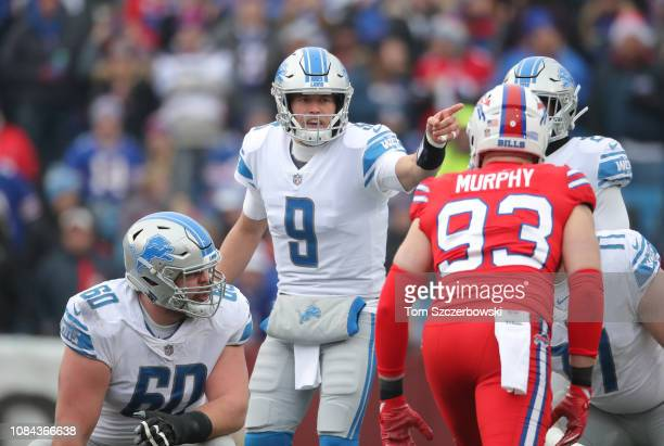Matthew Stafford of the Detroit Lions calls an audible as Graham Glasgow watches in the first quarter during NFL game against the Buffalo Bills at...