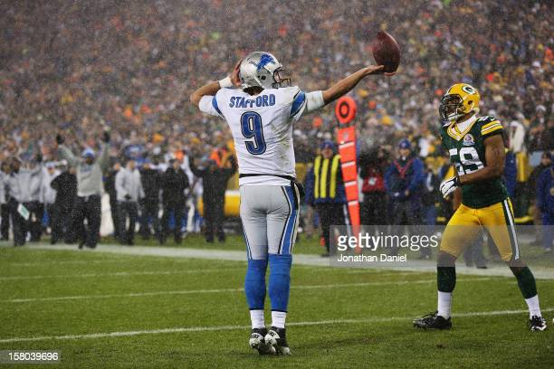 Matthew Stafford of the Detroit Lions celebrates in the end zone after scoring against the Green Bay Packers at Lambeau Field on December 9 2012 in...