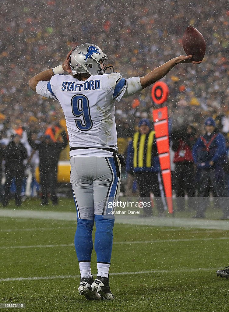 Matthew Stafford #9 of the Detroit Lions celebrates scoring a touchdown against the Green Bay Packers at Lambeau Field on December 9, 2012 in Green Bay, Wisconsin. The Packers defeated the Lions 27-20.