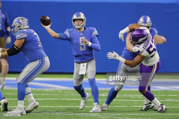 Matthew Stafford of the Detroit Lions drops back to pass during the first quarter of the game against the Minnesota Vikings at Ford Field on January...