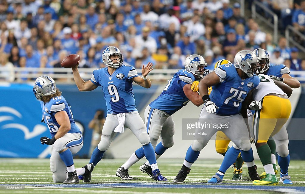 Matthew Stafford #9 of the Detroit Lions drops back to pass during the second quarter of the game against the Green Bay Packers at Ford Field on September 21, 2014 in Detroit, Michigan. The Lions defeated the Packers 19-7.