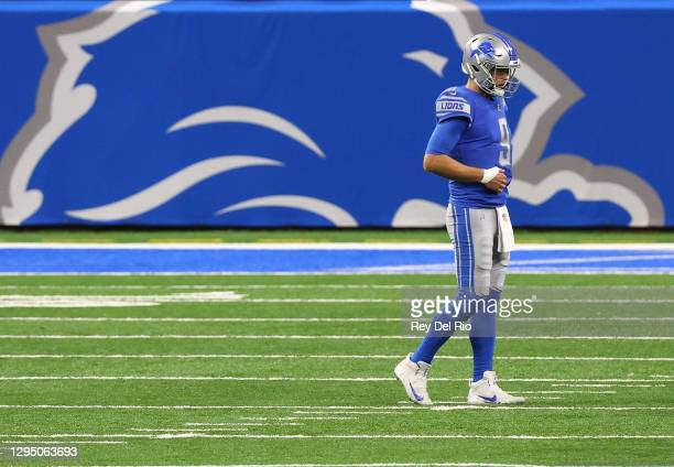 Matthew Stafford of the Detroit Lions grabs his side during a game against the Minnesota Vikings at Ford Field on January 3, 2021 in Detroit,...