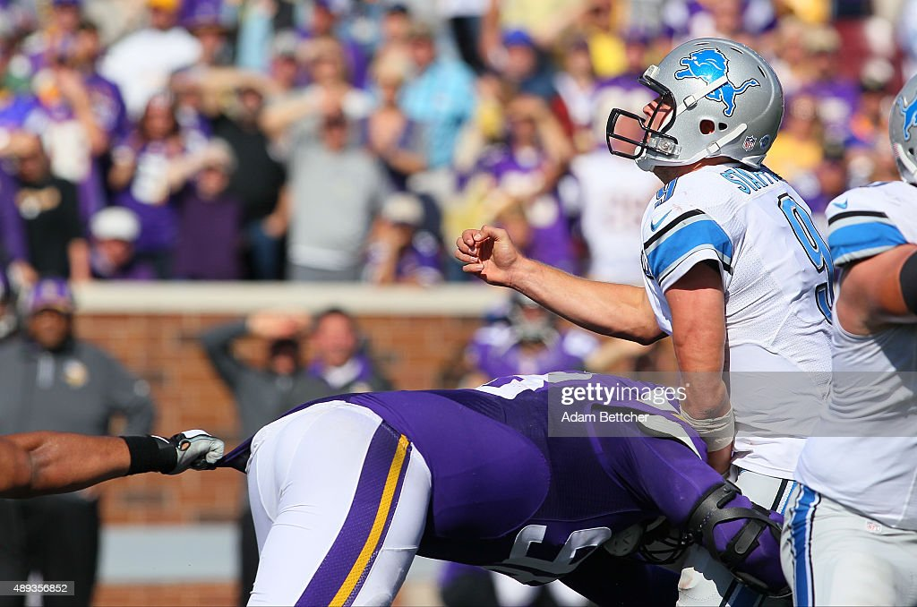Matthew Stafford #9 of the Detroit Lions grimaces while being hit by Linval Joseph #98 of the Minnesota Vikings in the fourth quarter at TCF Bank Stadium on September 20, 2015 in Minneapolis, Minnesota.