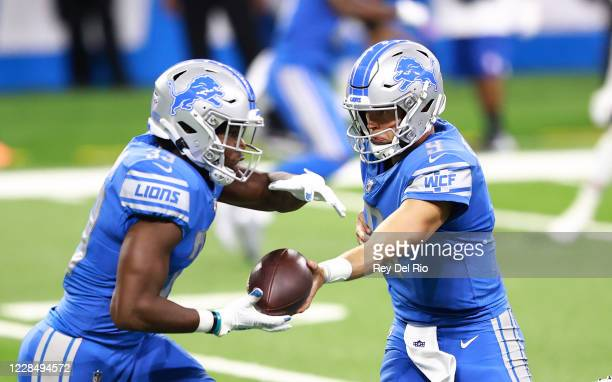Matthew Stafford of the Detroit Lions hands the ball off to Kerryon Johnson of the Detroit Lions during the first quarter of the game against the...