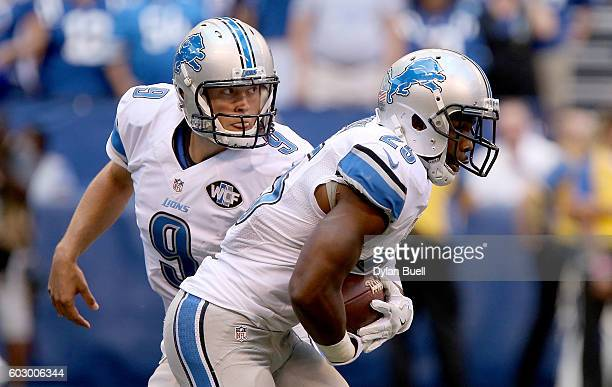 Matthew Stafford of the Detroit Lions hands the ball off to Theo Riddick of the Detroit Lions during the third quarter of the game against the...