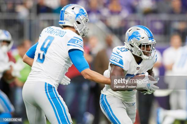 Matthew Stafford of the Detroit Lions hands the ball to teammate Kerryon Johnson during the game against the Minnesota Vikings at US Bank Stadium on...