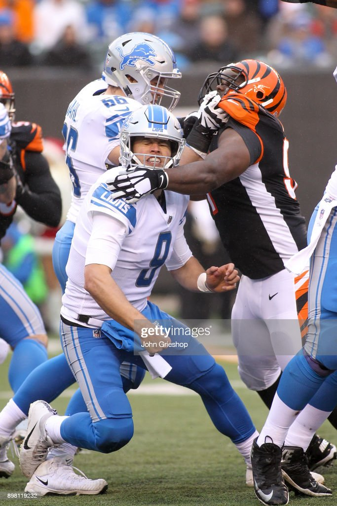 Matthew Stafford #9 of the Detroit Lions is hit after throwing a pass against the Cincinnati Bengals during the second half at Paul Brown Stadium on December 24, 2017 in Cincinnati, Ohio.