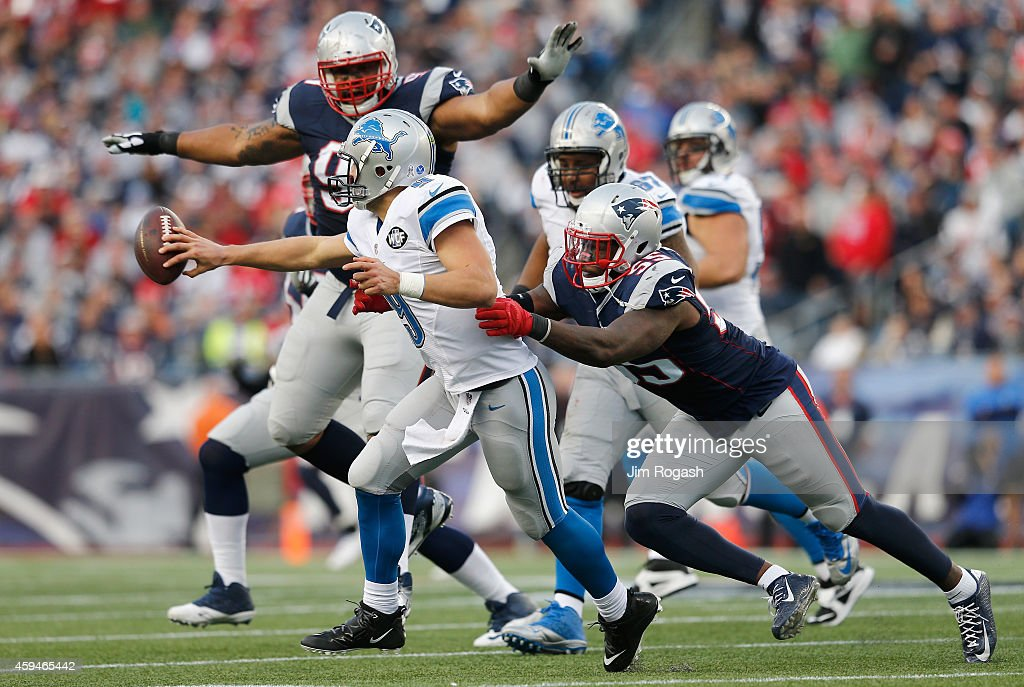 Matthew Stafford #9 of the Detroit Lions is tackled by Akeem Ayers #55 of the New England Patriots during the fourth quarter at Gillette Stadium on November 23, 2014 in Foxboro, Massachusetts.