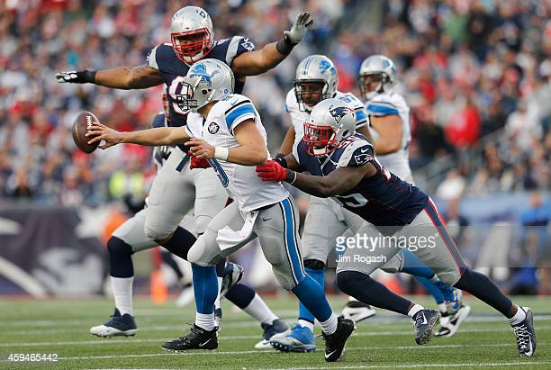 Matthew Stafford of the Detroit Lions is tackled by Akeem Ayers of the New England Patriots during the fourth quarter at Gillette Stadium on November...