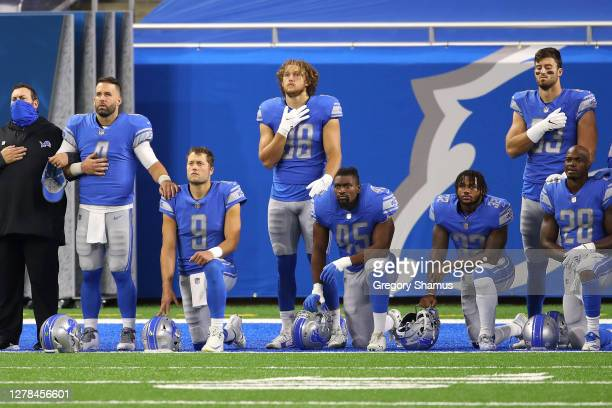 Matthew Stafford of the Detroit Lions kneels for the National Anthem prior to playing the New Orleans Saints at Ford Field on October 04, 2020 in...