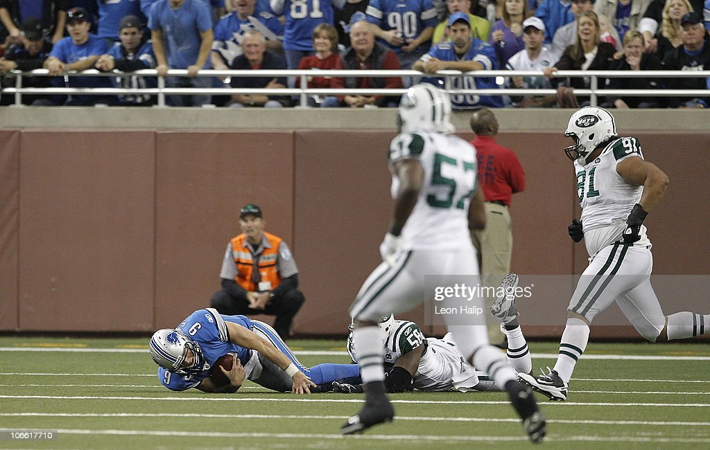 Matthew Stafford #9 of the Detroit Lions lays on the ground after being sacked by Bryan Thomas #58 of the New York Jets during the third quarter of the game at Ford Field on November 7, 2010 in Detroit, Michigan. The Jets defeated the Lions 23-20 in overtime.