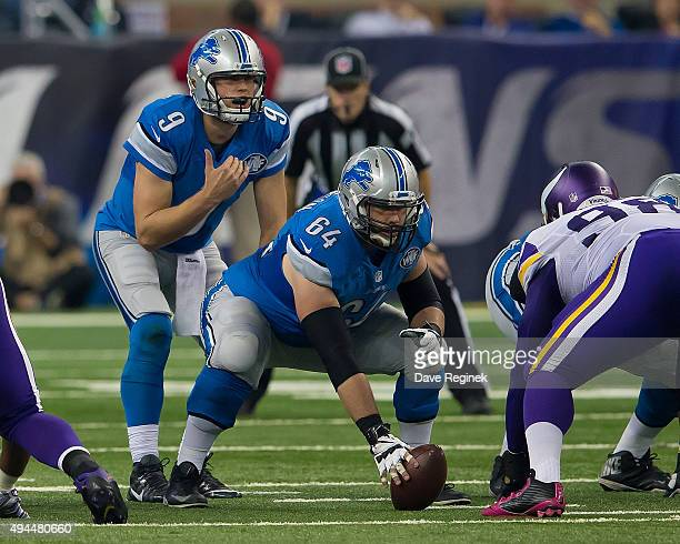 Matthew Stafford of the Detroit Lions lines up behind center Travis Swanson during an NFL game against the Minnesota Vikings at Ford Field on October...