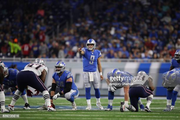 Matthew Stafford of the Detroit Lions lines up in the second quarter while playing the New England Patriots during a preseason game at Ford Field on...