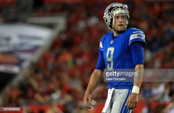 Matthew Stafford of the Detroit Lions looks on during a preseason game against the Tampa Bay Buccaneers at Raymond James Stadium on August 24 2018 in...