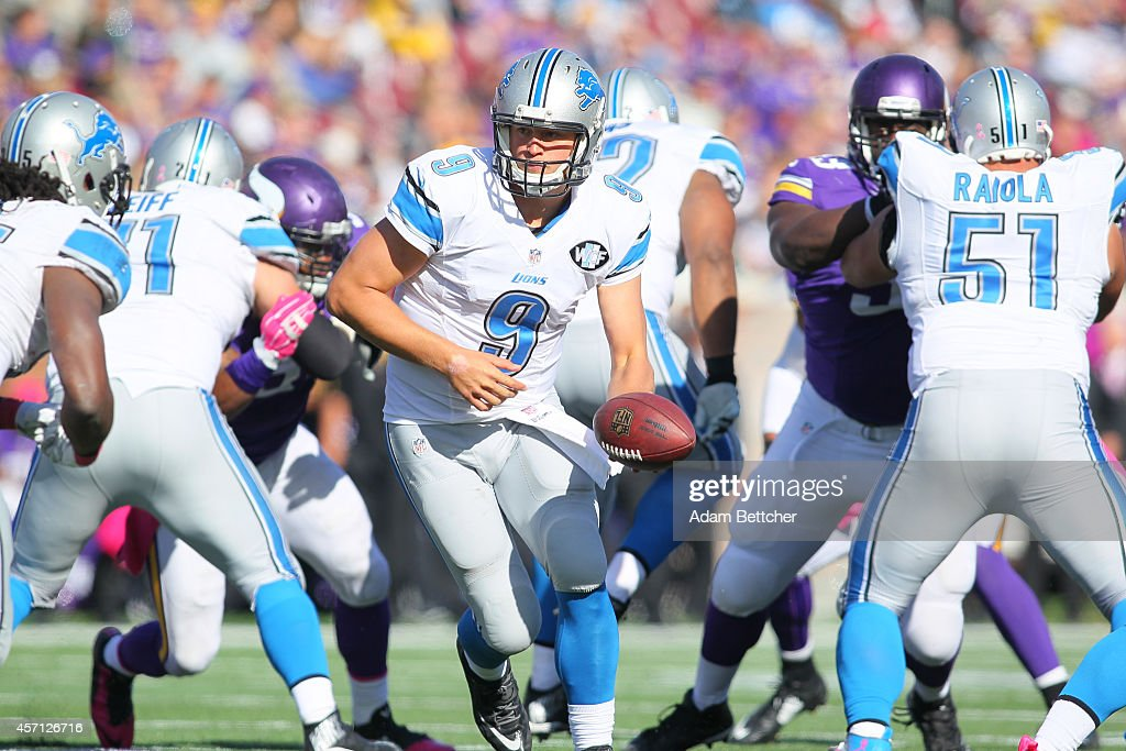 Matthew Stafford #9 of the Detroit Lions looks to hand off during the fourth quarter against the Minnesota Vikings on October 12, 2014 at TCF Bank Stadium in Minneapolis, Minnesota.
