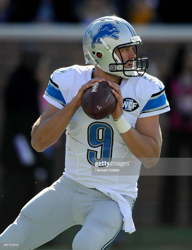 Matthew Stafford #9 of the Detroit Lions looks to pass the ball during the second quarter of the game on October 12, 2014 at TCF Bank Stadium in Minneapolis, Minnesota.