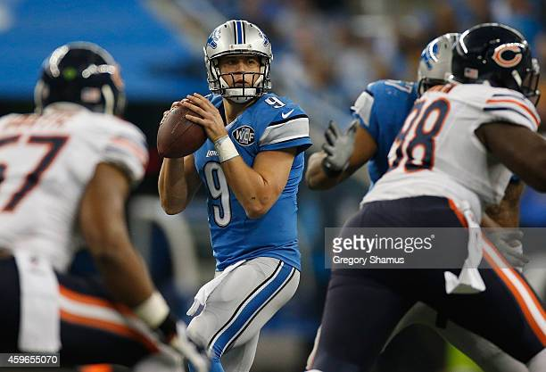 Matthew Stafford of the Detroit Lions looks to throw a first quarter pass against the Chicago Bears at Ford Field on November 27 2014 in Detroit...
