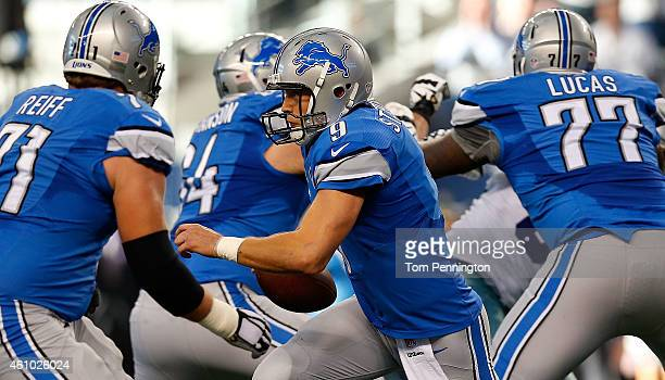 Matthew Stafford of the Detroit Lions moves from the pocket as Riley Reiff of the Detroit Lions Travis Swanson of the Detroit Lions and Cornelius...