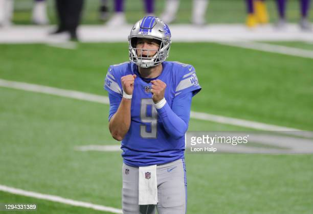 Matthew Stafford of the Detroit Lions reacts after a dropped pass for a two-point conversion during the fourth quarter of the game against the...
