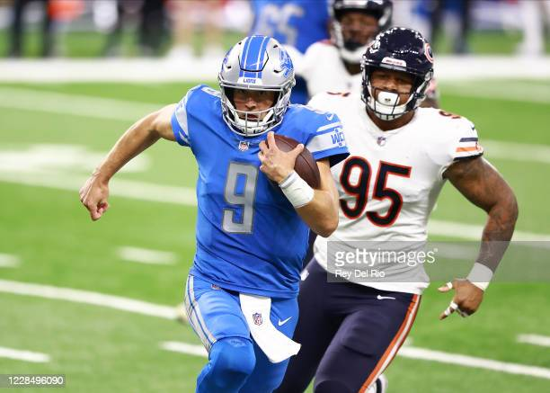 Matthew Stafford of the Detroit Lions runs for a first down during the second quarter of the game against the Chicago Bears at Ford Field on...