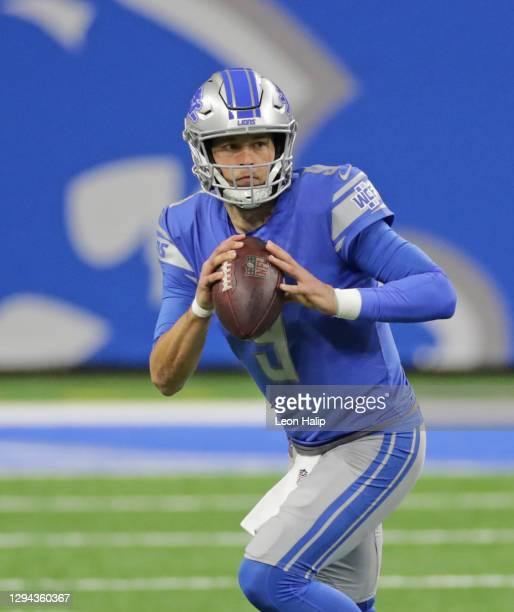 Matthew Stafford of the Detroit Lions runs for a first down during the third quarter of the game against the Minnesota Vikings at Ford Field on...