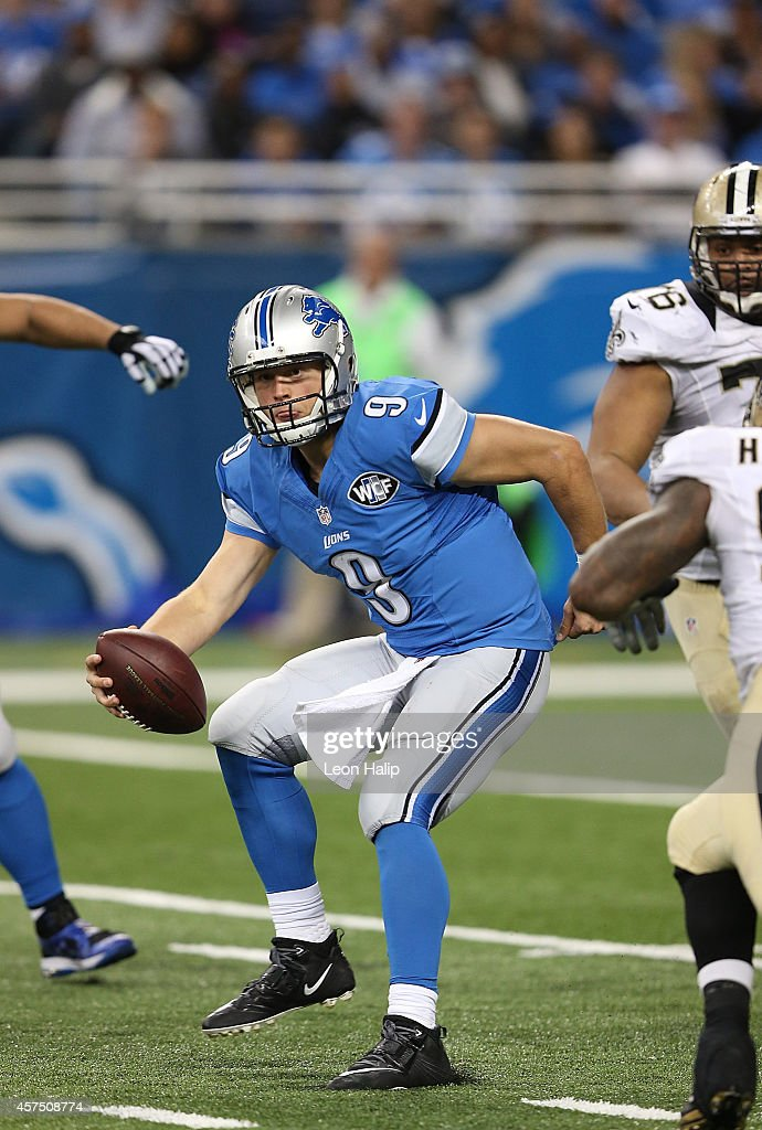 Matthew Stafford #9 of the Detroit Lions scrambles during the third quarter of the game against the New Orleans Saints at Ford Field on October 19, 2014 in Detroit, Michigan. The Lions defeated the Saints 24-23.