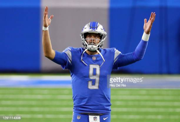 Matthew Stafford of the Detroit Lions signals for a touchdown during the second half against the Green Bay Packers at Ford Field on December 13, 2020...