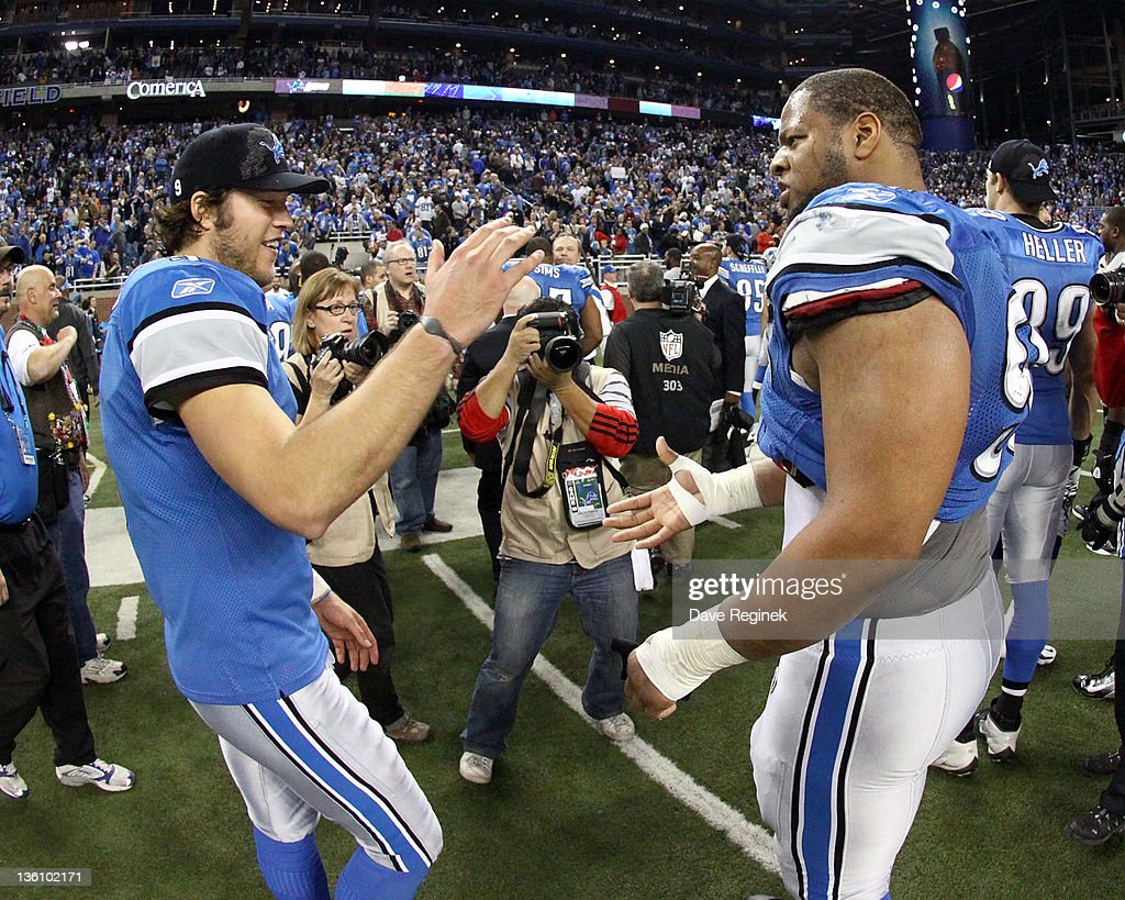 Matthew Stafford #9 of the Detroit Lions slaps hands with teammate Ndamukong Suh #90 after a NFL game against the San Diego Chargers at Ford Field on December 24, 2011 in Detroit, Michigan. The Lions won 38-10.