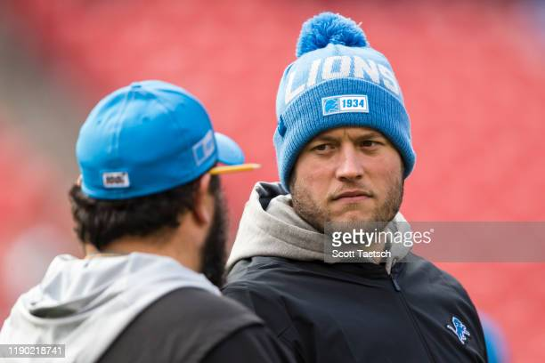 Matthew Stafford of the Detroit Lions speaks with head coach Matt Patricia before the game against the Washington Redskins at FedExField on November...