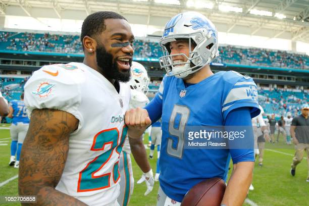 Matthew Stafford of the Detroit Lions talks with Xavien Howard of the Miami Dolphins after the game at Hard Rock Stadium on October 21 2018 in Miami...
