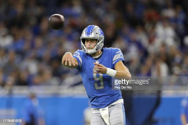 Matthew Stafford of the Detroit Lions throws a pass to Danny Amendola in the third quarter against the New York Giants at Ford Field on October 27...