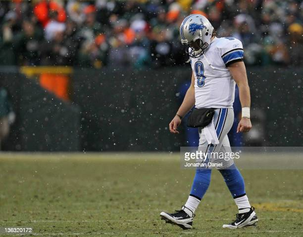 Matthew Stafford of the Detroit Lions walks off of the field after throwing an interception to the Green Bay Packers with 30 seconds on the clock at...