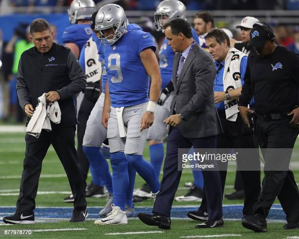 Matthew Stafford of the Detroit Lions walks off the field after injuring his foot in the second half against the Minnesota Vikings during an NFL game...