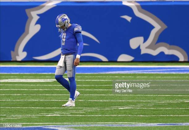 Matthew Stafford of the Detroit Lions walks to the sidelines in the second quarter of the game against the Minnesota Vikings at Ford Field on January...
