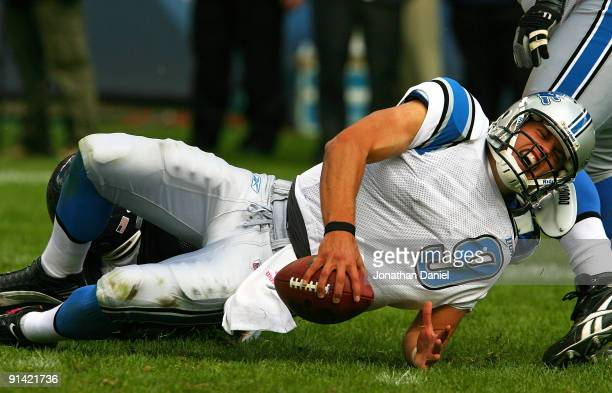 Matthew Stafford of the Detroit Lions yells as he is sacked by Adewale Ogunleye of the Chicago Bears on October 4 2009 at Soldier Field in Chicago...