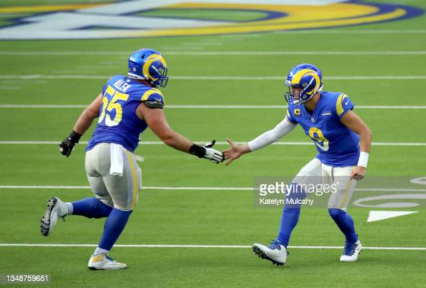 Matthew Stafford of the Los Angeles Rams celebrates with Brian Allen after a successful 2-point conversion in the fourth quarter against the Detroit...