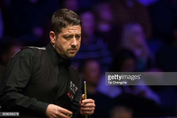 Matthew Stevens of Wales chalks the cue during his fourth round match against Yan Bingtao of China on day four of 2018 ManBetX Welsh Open at...