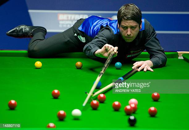 Matthew Stevens of Wales plays a shot during the first round match of the World Championship Snooker tournament against Marco Fu of Hong Kong at the...