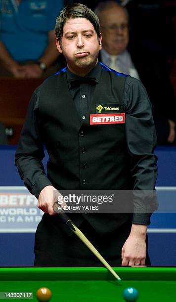 Matthew Stevens of Wales reacts during the first round match of the World Championship Snooker tournament against Marco Fu of Hong Kong at the...