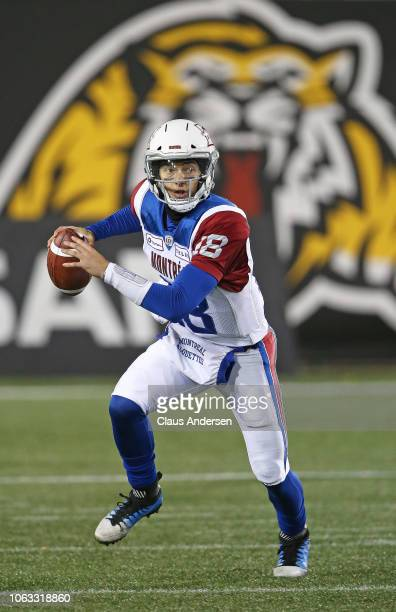 Matthew Stiltz of the Montreal Alouettes rolls out to make a pass against the Hamilton TigerCats in a CFL game at Tim Hortons Field on November 3...