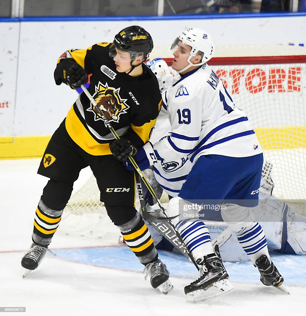 Matthew Strome #18 of the Hamilton Bulldogs is tied up by Ian McKinnon #19 of the Mississauga Steelheads during game action on December 10, 2017 at Hershey Centre in Mississauga, Ontario, Canada.
