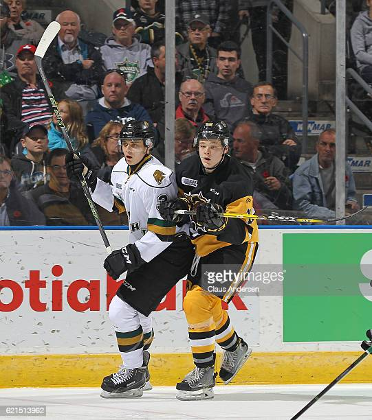 Matthew Strome of the Hamilton Bulldogs skates against Nicolas Mattinen of the London Knights during an OHL game at Budweiser Gardens on November 6...