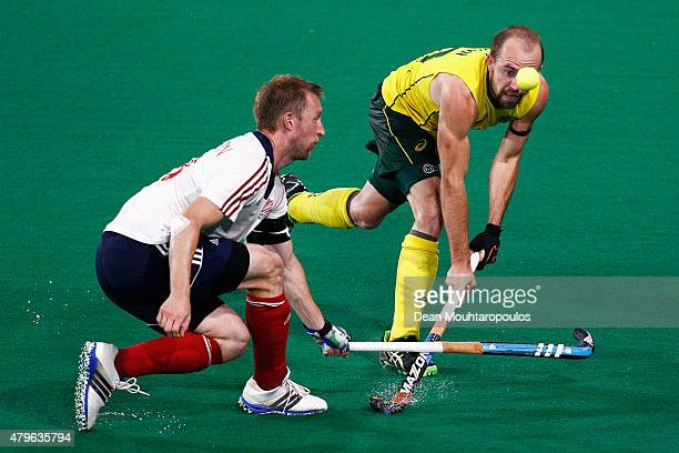 Matthew Swann of Australia attempts to stop Barry Middleton of Great Britain shooting on goal during the Fintro Hockey World League SemiFinal match...