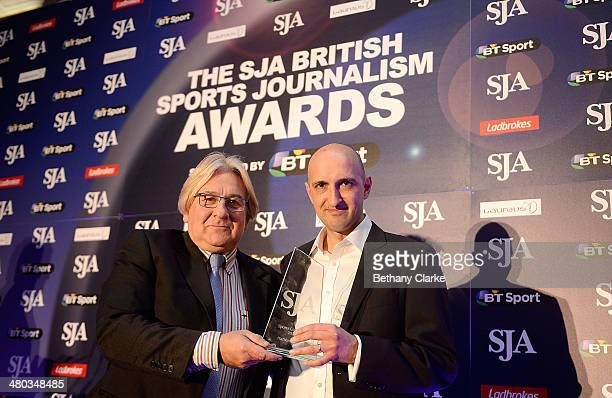 Matthew Syed from The Times newspaper receives the Sports Columnist Award from Mike Lee during the SJA British Sports Journalism Awards Ceremony at...