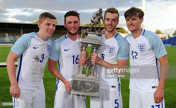 Matthew Targett Matthew Grimes Calum Chambers and John Swift of England pose with the trophy during the Final of the Toulon Tournament between...