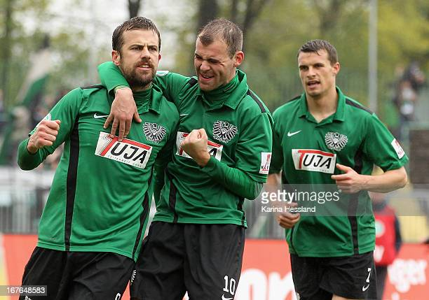Matthew Taylor, Amaury Bischoff and Philip Heise of Muenster celebrate the goal to 1:1 of Matthew Taylor during the 3rd Liga match between RW Erfurt...