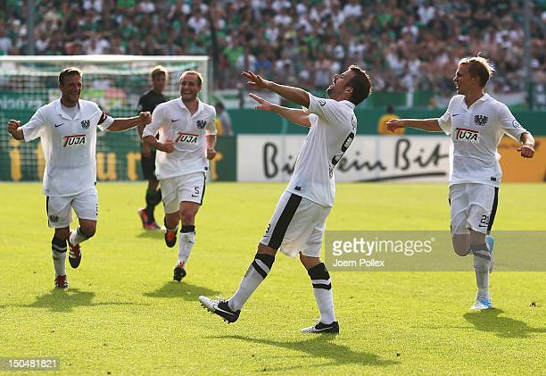Matthew Taylor of Muenster celebrates with his team mates after scoring his team's fourth goal during the DFB Cup first round match between Preussen...