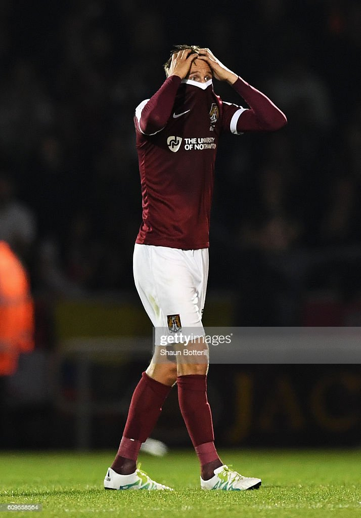 Matthew Taylor of Northampton Town looks dejected during the EFL Cup Third Round match between Northampton Town and Manchester United at Sixfields on September 21, 2016 in Northampton, England.