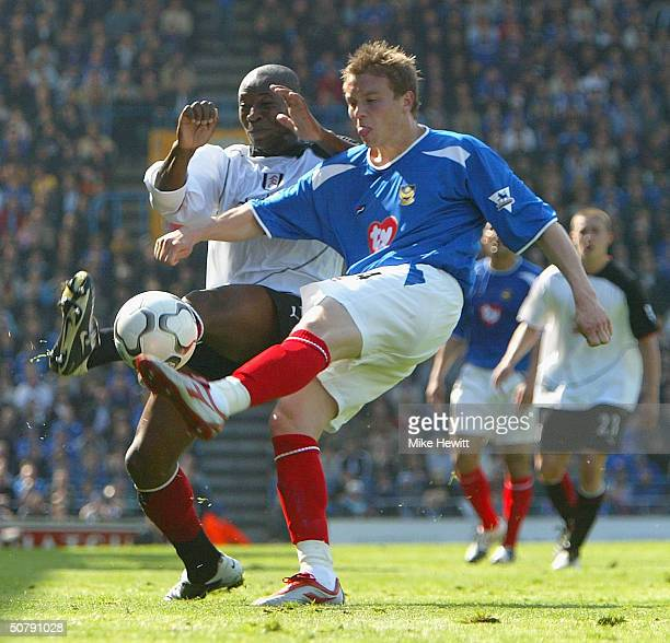 Matthew Taylor of Portsmouth is challenged by Luis Boa Morte of Fulham during the FA Barclaycard Premiership match between Portsmouth and Fulham at...