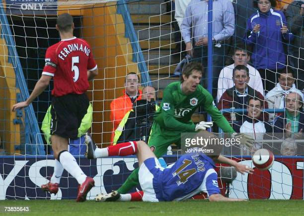 Matthew Taylor of Portsmouth scores their first goal past Edwin van der Sar during the Barclays Premiership match between Portsmouth and Manchester...